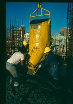 Fletcher Development & Construction Ltd: 1981 Builders positioning a cement pourer