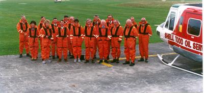 Fletcher Challenge Ltd: 1992 Board of Directors visit to Maui B platform - Hugh A Fletcher, Sir Ron Trotter, Garry Mace, Mike Andrews, Kerrin Vautier, George Pearce, McKellar, Bill Wilson, Southern, and Blanchard; also L McLeod of Petrocorp Exploration, J Shane and Gary Key, as well as the helicopter and pilots