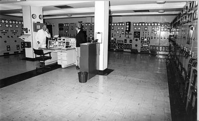 Tasman Pulp & Paper Co Ltd, Kawerau: 1982 A Lawson and Bill McCarthy working at computer console in electrical control room; 1982; Photograph