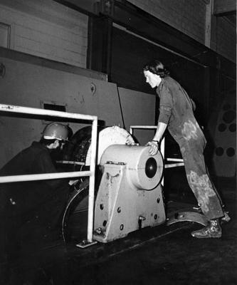 Tasman Pulp & Paper Co Ltd, Kawerau: 1982 A Finlay and K Brown checking on grinder motors; 1982; Photograph