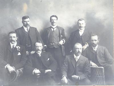 Wright Stephenson & Co Ltd - Gore Branch, Southland: 1910 Stock & Station Agents - Back row P C McGray; John T Martin (WS&Co); A Scott (Henderson & Co); Front row W Gee (J E Stewart & Co); ? Sharp (NZ Loan & MA Co); A MacAloon (National Mortgage & Co Ltd); R K Smith (Dalgety & Co Ltd);