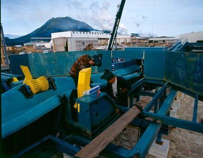 Tasman Pulp & Paper Co Ltd, Kawerau: 1989 men repairing a machine at the mill; 1989; Photograph