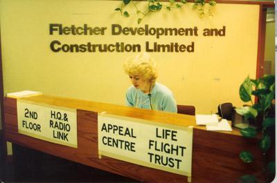 Fletcher Development & Construction Ltd, Wellington: 1984 FD&C aids radio appeal for Westpac Rescue helicopter - Receptionist B O'Bierne takes pledges