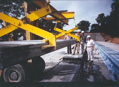 Fletcher Construction Co Ltd: Overseas Division - 1982 Singapore Kentridge Hospital - OD staff supervising lifting of floor unit
