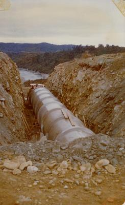 Hume Industries (NZ) Ltd - Hume Pipe Co: 1977 Taramakau River, West Coast - penstock pipes in place for hydro scheme