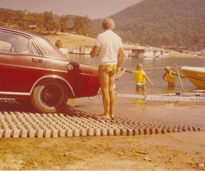 Hume Industries (NZ) Ltd - Hume Pipe Co: 1975 man standing on turf pavers [gobi blocks]
