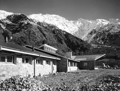 Fletcher Construction Co Ltd - The Hermitage, Aoraki/Mt Cook: 1958 back exterior view of kitchen & lounge