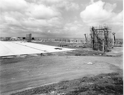 Fletcher Construction Co Ltd - Hangar and Workshop for TEAL, Auckland Airport, Mangere: 1964 comprehensive view of the project under construction