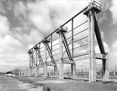 Fletcher Construction Co Ltd - Hangar and Workshop for TEAL, Auckland Airport, Mangere: 1964 under construction, back buttress and scaffolding