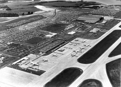 Fletcher Construction Co Ltd - Hangar and Workshop for TEAL, Auckland Airport, Mangere: 1966 Aerial view of the opening; Fletcher Holdings' company plane, a Cessna 310G, was present