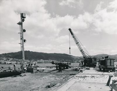 Fletcher Construction Co Ltd - Clyde Quay Wharf Extensions / Overseas Passenger Terminal, Oriental Bay, Wellington: 1964 during construction (crane)