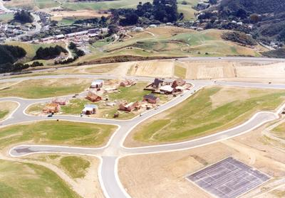 Fletcher Construction Co Ltd - Residential housing developments: 1976 Grenada Village, Wellington - subdivision (before houses, roads only)