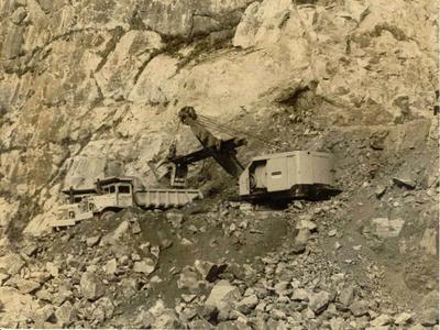 Fletcher Construction Co Ltd, Engineering Division - Ohakuri Diversion Tunnel: 1958 Excavator working in typical Ohakuri terrain