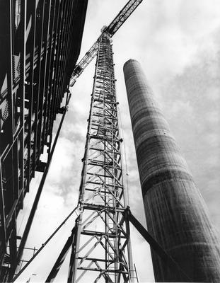 Fletcher Construction Co Ltd - New Plymouth Power Project, Taranaki: 1972 under construction - chimney and crane