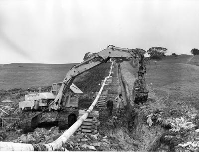 Fletcher Construction Co Ltd - Contracts - Kapuni Gas Pipeline, Taranaki to Auckland/Wellington: 1969 Te Kuiti, King Country - Digging trench and various views of countryside (18 items)