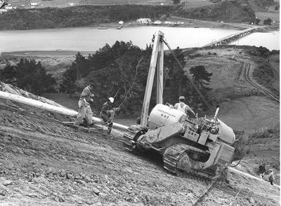 Fletcher Construction Co Ltd - Contracts - Kapuni Gas Pipeline, Taranaki to Auckland/Wellington: 1969 Caterpillar moving down the last hill to Mokau River, King Country