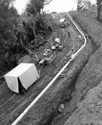 Fletcher Construction Co Ltd - Contracts - Kapuni Gas Pipeline, Taranaki to Auckland/Wellington: 1969 Various views of laying the pipeline (10 items)