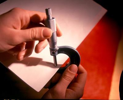 Tasman Pulp & Paper Co Ltd, Kawerau: 1997 Micrometer being used to measure paper thickness