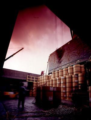 Tasman Pulp & Paper Co Ltd: 1991 newsprint reels being unloaded in Hong Kong