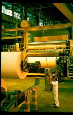 Tasman Pulp & Paper Co Ltd, Kawerau: 1991 No.3 paper machine - Selwyn Rangi operating the crane to move twelve tonne reel of paper