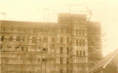 Photographs related to the career of Jimmy Hill with Fletcher Construction Co: 1942 Green Lane Hospital, Auckland main block construction site - almost completed building; scaffolding still in place