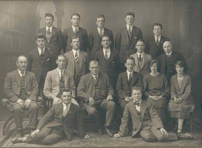 Wright Stephenson & Co Ltd - Gore Branch, Southland: 1925 staff - Back row D McKenzie; C Fleming; D Faitt; G Blaikie; P Craig; Middle row P Craig; T Gray; R Chatterton; R E Blair; S G Phillips; A M Corbett; Front row G Greer; G Elvidge; P C Gray; H R Robertson; Miss A L Thomson; Miss C E Chatteron; Sitting in front J Broome; N Corbett; (A Tinnock absent).