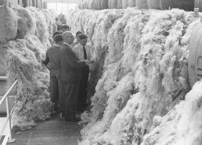 Wright Stephenson & Co Ltd - Invercargill Branch, Southland: 1957 Buyers inspecting wool in the Wool Store