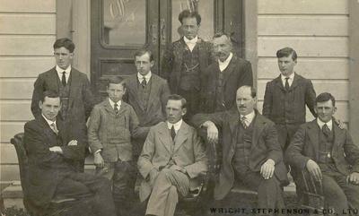 Wright Stephenson & Co Ltd - Gore Branch, Southland: 1913 Edendale sub-agency - staff (l-r) T J Scoular; P J Ballantyne; T N McKenzie; J Bogue; C McPherson; N B Compton; Sitting - (l-r) J C McCrae; H A Price; G Dempster; R Robertson;