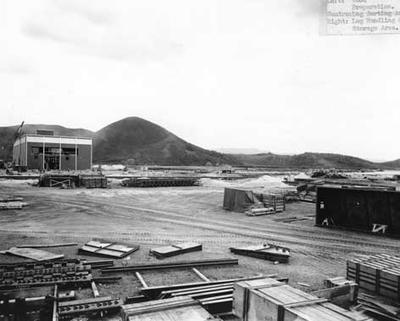 Tasman Pulp & Paper Co Ltd: Sep1954 Kawerau mill construction (left) wood preparation centre - sorting area (right) log handling and storage area