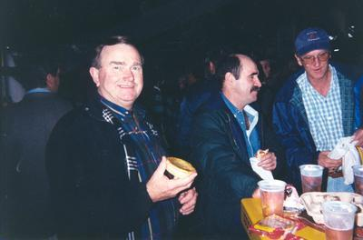 Golden Bay Cement Co: 2000 3x men celebrating with pies and beer [Noel ? at Suncorp Stadium]